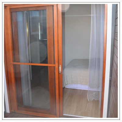 cedar sliding door with fly screen